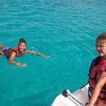 Swimming in sea off a pedalo