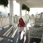 My daughter on the deck (early morning) of the Pines County Inn