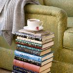 Curl up in one of our comfy chairs with a book. Forgot your? Borrow one of ours!