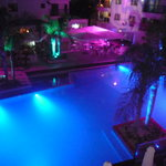 A view of the pool at night from one the the pool side rooms!