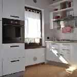 Cucina dell'appartamento Rosso