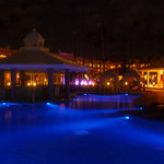 the pool and grounds all lit up at night