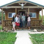 Dwight & Arlene (center) with us in front of the cabin we stayed in