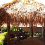 Relax under the Bali hut and watch the sea.