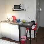 Kitchen table at the the room for 3 person. Eat on your knees!