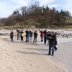 Birders on Lake Michigan shore at Indiana Dunes