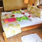 Flowers and fancy towelwork adorn your bed each day