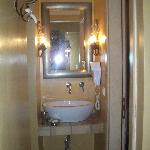 The sink, located at the corner of the room. The shower and the wc were seperated
