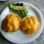 Crab sandwhich on English muffin with cheese