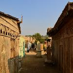 wooden houses housing a tomb