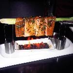 Flaming Salmon - Salmon sashimi, layed over a lemon grass stalk above flaming beans