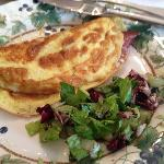 Omelet with cured meats and salad