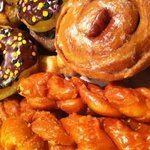 Frosted donuts, cinnamon roll, orange twist