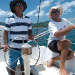 Mate Bismark at the helm capitan jack trimming sails