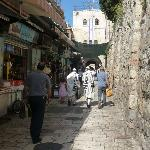 The street directly at the entrance of the hospice. The hospice walls on the right, the Damascus
