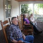 Enjoying the rocking chairs on the porch.
