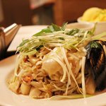 My meal at Wild Ginger - Spicy Thai Noodles with Seafood (Mango Sorbet in the background)