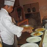 Chef Pujols Serving his signature dish.