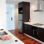 Kitchen area near entrance with all crockery, pots, utensils and kitchen amenities you can ever