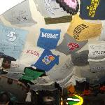 College T-Shirts lining the roof of the bar