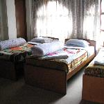 Photo of room with 3 beds