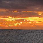 Surfers at sunset, Poipu Beach, Kauaii