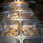 Skewered chicked, also battered & fried, eggrolls, rangoon, & soups on end.