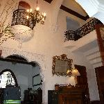 The foyer. Two rooms have internal Juliet balconies.