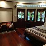 A villa bedroom at Santitham Guest House