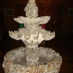 a fountain made of corrals and shells