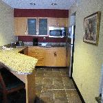 Stainless appliances, Corian counters, full-size coffee pot, full-size fridge, nice lighting!