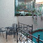 Quiet balcony overlooking courtyard