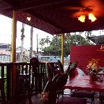 Outdoor seating area. Friends passing by stop and join you.