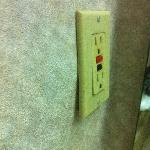 Loose/inoperative bathroom electrical outlet