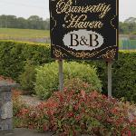 Front sign and hedges.