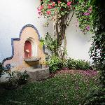 garden with fountain at entrance