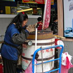 Miss Wong manages, cooks and sells Taiwanese sweet potatoes, or yams, using a traditional oven.