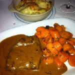very tender pepper steak with potayo gratin and glazed carrits, its delicious but a lot