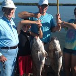 The kids had a great time after catching these black drum!