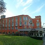 The strikingly orange Hotel Monopole