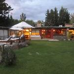 grounds with pool and games room and bar with Asado in background