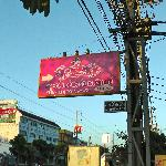 Pink hotel sign at mouth of soi (lane)