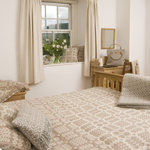 bedspread in neutral colours