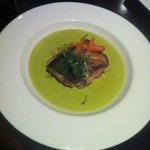 oven roasted cod with a pea and mint veloute, baby carrotts and mixed baby leaves
