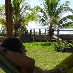 Son Dominic lounging in lodge hammock with waves 20 yards away
