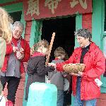 Children receive lucky candies