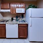 Enjoy fully-stocked kitchens including a full size refrigerator