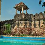 Swimming pool under the ancient temple walls