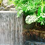 This is the hot spring pool and artificial waterfall described in our review.