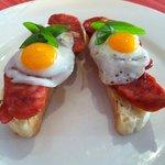 quail eggs & chorizo montaditto